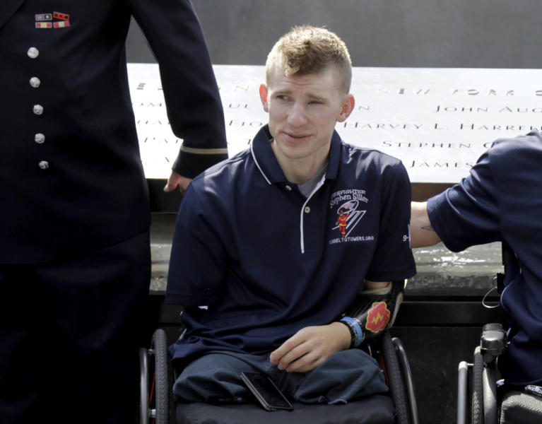 FILE - In this July 4, 2012 file photo, Army Sgt. Brendan Marrocco of Staten Island, N.Y., wearing a prosthetic arm, poses for a picture at the 9/11 Memorial in New York. Marrocco, 26, the first soldier to survive losing all four limbs in the Iraq war, has received a double-arm transplant in Baltimore. His father, Alex Marrocco, said Monday, Jan. 28, 2013 that his son had the operation on Dec. 18, 2012 at Johns Hopkins Hospital. (AP Photo/Seth Wenig, File)