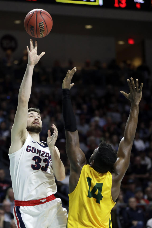 Gonzaga's Killian Tillie (33) shoots as San Francisco's Charles Minlend defends during the first half of an NCAA college basketball game in the West Coast Conference men's tournament Monday, March 9, 2020, in Las Vegas. (AP Photo/Isaac Brekken)