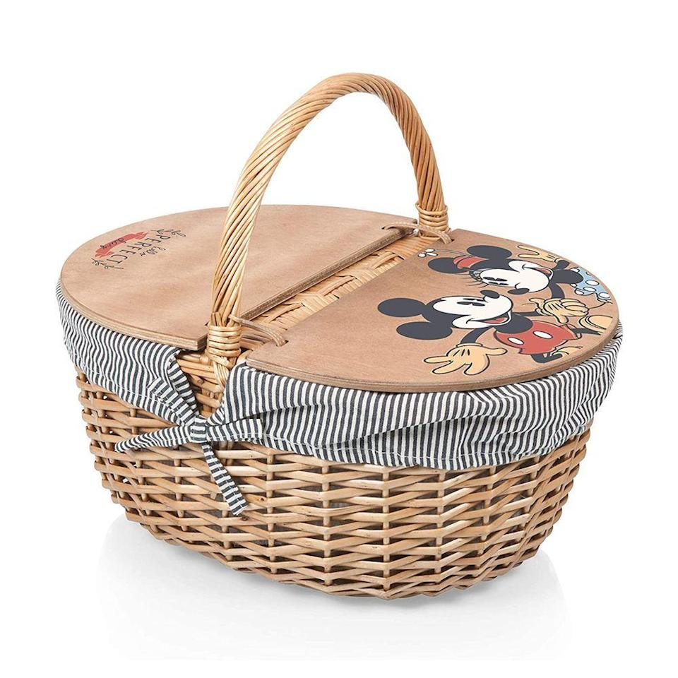 """<p><strong>Picnic Time</strong></p><p>amazon.com</p><p><a href=""""https://www.amazon.com/dp/B07XQKJXLL?tag=syn-yahoo-20&ascsubtag=%5Bartid%7C2089.g.36560252%5Bsrc%7Cyahoo-us"""" rel=""""nofollow noopener"""" target=""""_blank"""" data-ylk=""""slk:Shop Now"""" class=""""link rapid-noclick-resp"""">Shop Now</a></p><p>There's something so charming about a picnic basket, and that's especially true with this wicker one, featuring the striped materials and Mickey and Minnie Mouse details on the top. All we have to figure out is what we're going to fill the basket with!</p>"""