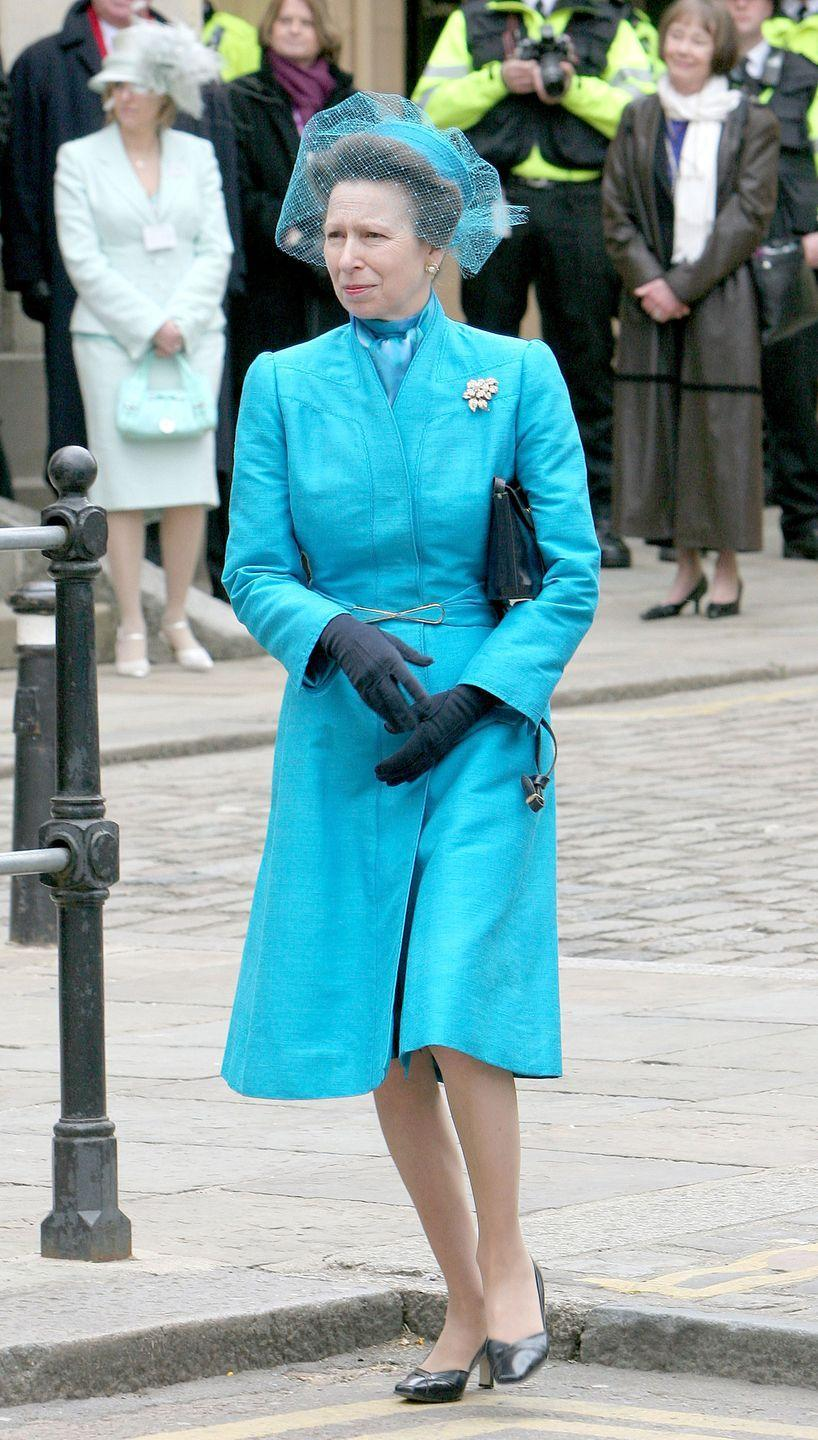 """<p>Here's Princess Anne in a bright blue cap complete with veil at her brother's wedding to Camilla Parker Bowles. </p><p><strong><a href=""""https://www.townandcountrymag.com/society/tradition/g12014434/princess-anne-princess-royal-photos/"""" rel=""""nofollow noopener"""" target=""""_blank"""" data-ylk=""""slk:More: Princess Anne's Life in Pictures"""" class=""""link rapid-noclick-resp"""">More: Princess Anne's Life in Pictures</a></strong><br></p>"""