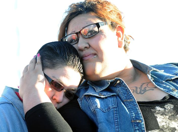 Vanessa Baeza embraces her spouse Moe during a rally to celebrate New Mexico Supreme Court ruling on Thursday, Dec. 19, 2013, in Las Cruces, N.M. The state's highest court declared it was unconstitutional to deny marriage licenses to gay and lesbian couples. (AP Photo/The Las Cruces Sun-News, Robin Zielinski)