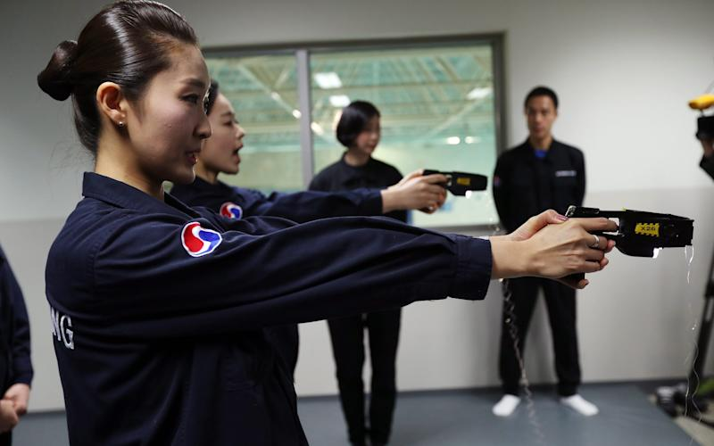 Flight attendants of Korean Air Lines Co. learn how to use stun guns against in-flight violence