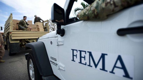PHOTO: In this Oct. 5, 2017 file photo, Department of Homeland Security personnel deliver supplies to Santa Ana community residents in the aftermath of Hurricane Maria in Guayama, Puerto Rico. (Carlos Giusti/AP, File)