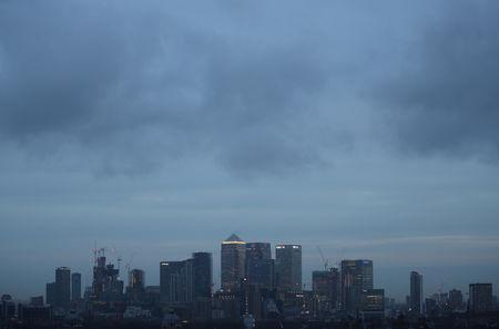FILE PHOTO: The Canary Wharf financial district is seen during early morning mist from Greenwich Park in London