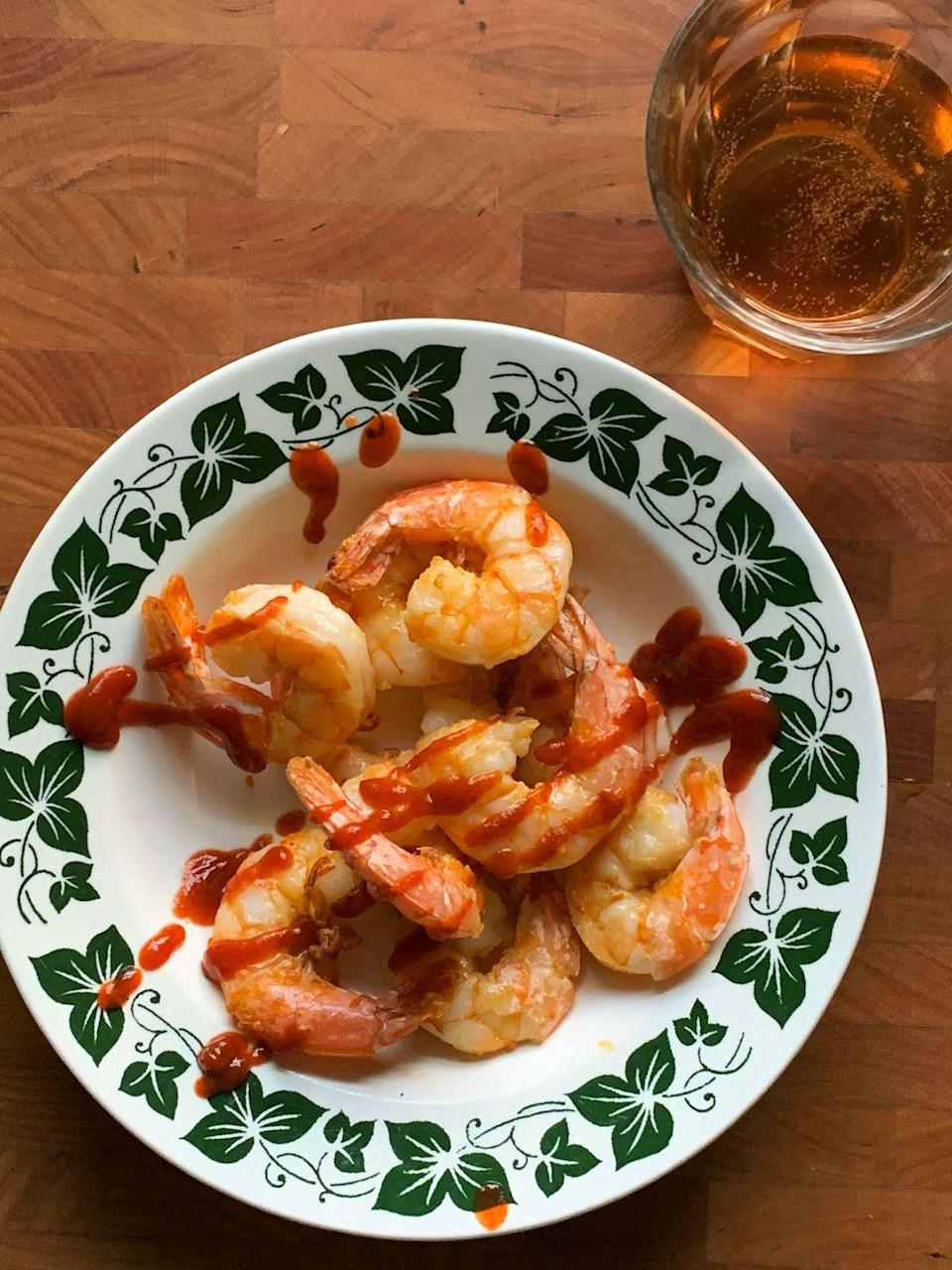 """<p>With an air fryer, these shrimp go from fully frozen to ready-t0-eat in about 25 minutes. They're perfect for healthy last-minute meals, and are great for salads, pasta, or more.</p><p><strong><a href=""""https://www.countryliving.com/food-drinks/a35671696/air-fryer-shrimp/"""" rel=""""nofollow noopener"""" target=""""_blank"""" data-ylk=""""slk:Get the recipe"""" class=""""link rapid-noclick-resp"""">Get the recipe</a>.</strong> </p>"""