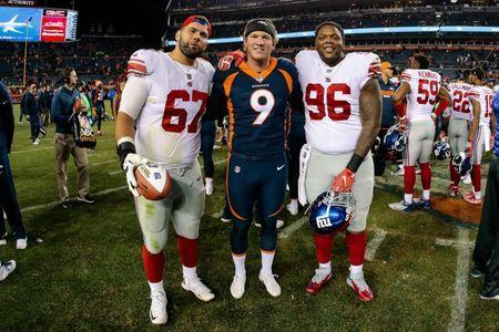 FILE PHOTO: Oct 15, 2017; Denver, CO, USA; Denver Broncos punter Riley Dixon (9) poses for a picture with New York Giants offensive guard Justin Pugh (67) and defensive tackle Jay Bromley (96) after their game at Sports Authority Field at Mile High. Isaiah J. Downing-USA TODAY Sports