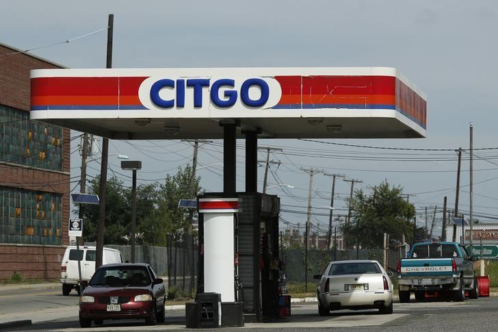 People wait for service in a Citgo gas station in Kearny, New Jersey