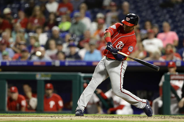 Washington Nationals' Juan Soto hits a two-run home run off Philadelphia Phillies starting pitcher Jake Arrieta during the fourth inning of the second game of a baseball doubleheader, Tuesday, Sept. 11, 2018, in Philadelphia. (AP Photo/Matt Slocum)