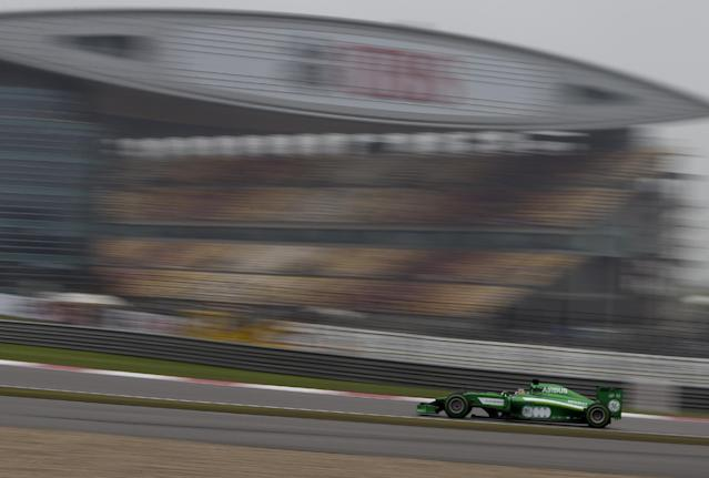 Caterham driver Kamui Kobayashi of Japan drives during his practice session for Sunday's Chinese Formula One Grand Prix at Shanghai International Circuit in Shanghai, China Saturday, April 19, 2014. (AP Photo/Andy Wong)