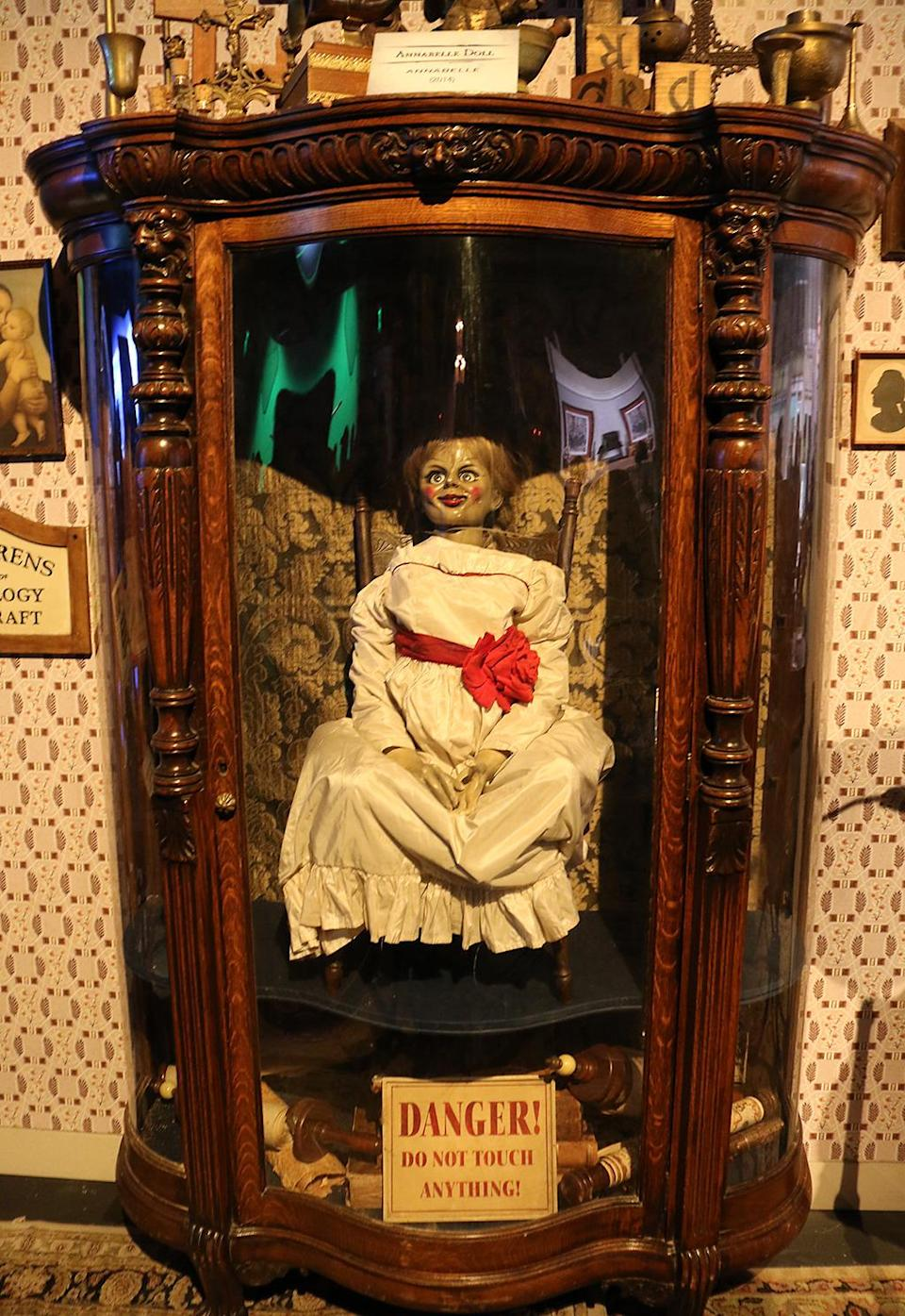 """<p>One of the <a rel=""""nofollow"""" href=""""https://www.yahoo.com/movies/how-the-real-doll-behind-annabelle-became-even-99081889057.html"""" data-ylk=""""slk:freaky dolls;outcm:mb_qualified_link;_E:mb_qualified_link;ct:story;"""" class=""""link rapid-noclick-resp yahoo-link"""">freaky dolls</a> used to scary effect in the horror franchise, locked in the cabinet from the storage room of the real-life investigators Ed and Lorraine Warren. (Photo: Angela Kim/Yahoo) </p>"""