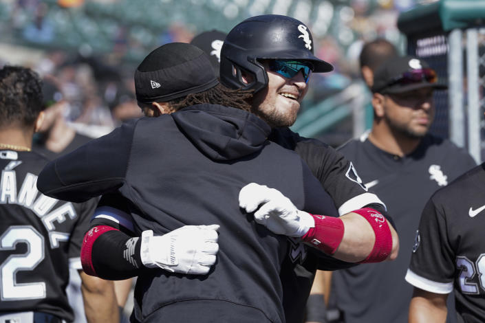 Chicago White Sox catcher Yasmani Grandal, right, celebrates his solo home run with Billy Hamilton in the fourth inning of a baseball game against the Detroit Tigers in Detroit, Monday, Sept. 27, 2021. (AP Photo/Paul Sancya)