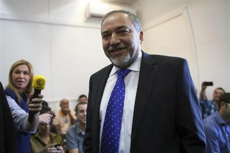 Former Israeli Foreign Minister Lieberman enters the courtroom to hear the verdict in the corruption charges against him at the Magistrate Court in Jerusalem