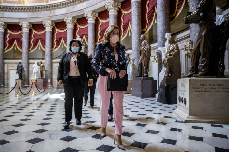 """House Speaker Nancy Pelosi of Calif. walks to a news conference on Capitol Hill in Washington, Wednesday, July 15, 2020, to mark two months since House passage of """"The Heroes Act"""" or the Health and Economic Recovery Omnibus Emergency Solutions act. (AP Photo/Andrew Harnik)"""