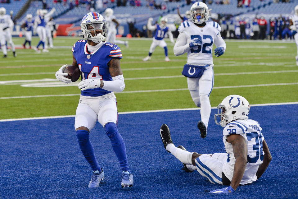 Buffalo Bills' Stefon Diggs (14) reacts after catching a pass in front of Indianapolis Colts' T.J. Carrie (38) during the second half of an NFL wild-card playoff football game Saturday, Jan. 9, 2021, in Orchard Park, N.Y. (AP Photo/Adrian Kraus)