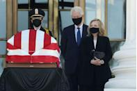 <p>Former U.S. President Bill Clinton and former Secretary of State Hillary Clinton pay their respects to Associate Justice Ruth Bader Ginsburg as her flag-draped casket is displayed on the west front of the U.S. Supreme Court September 23, 2020 in Washington, DC.</p>