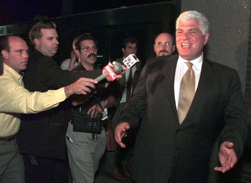 "FILE - In this Aug. 31, 1999 file photo, Major League Baseball umpires union chief Richie Phillips, right, gestures as he offers a ""no comment"" quote to reporters outside of the Federal Courthouse in Philadelphia. Phillips, a hard-charging negotiator for NBA referees and Major League Baseball umpires, has died. He was 72. Phillips' death was reported by The Philadelphia Inquirer, which said he died Friday, May 31, 2013 of cardiac arrest at his second home in Cape May, N.J. (AP Photo/Chris Gardner)"
