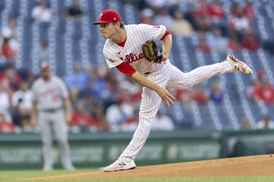 Philadelphia Phillies starting pitcher Spencer Howard throws during the first inning of a baseball game against the Washington Nationals, Monday, July 26, 2021, in Philadelphia. (AP Photo/Laurence Kesterson)