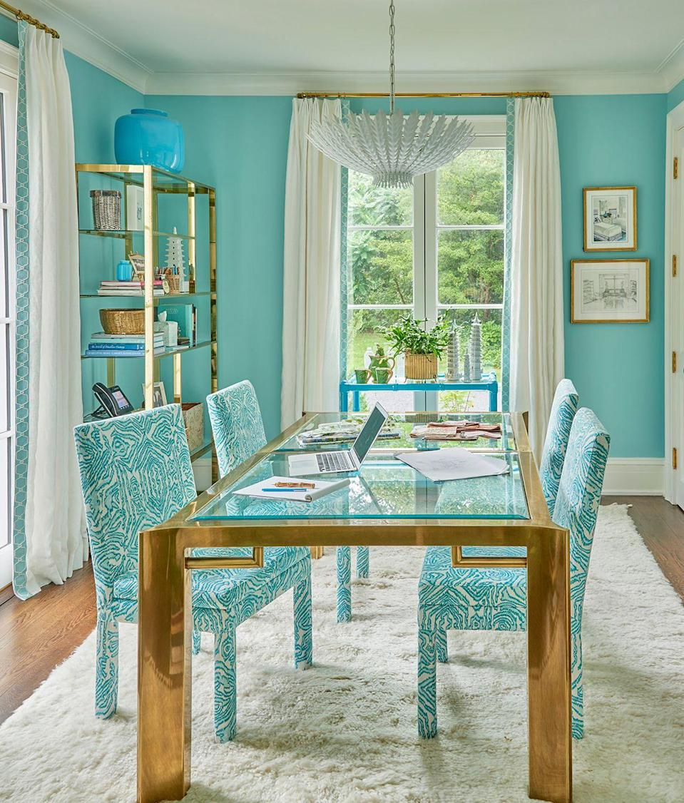 """<p><a href=""""https://www.megbraffdesigns.com"""" rel=""""nofollow noopener"""" target=""""_blank"""" data-ylk=""""slk:Meg Braff"""" class=""""link rapid-noclick-resp"""">Meg Braff</a> gets extra mileage from her dining room's bar cart in her New York home office. </p><p>""""In my home office in Locust Valley, I have a bar cart that I use to serve tea from and hold any overflow materials while I'm working,"""" says Braff. """"On the lower level, in the window, I keep dormant orchids until they are ready to rebloom."""" </p><p> The cheerful turquoise hue of this bar cart echoes the room's color scheme, and the chairs are covered in Braff's <a href=""""http://www.megbraffdesigns.com/fabrics#/vienna-woods-1/"""" rel=""""nofollow noopener"""" target=""""_blank"""" data-ylk=""""slk:Vienna Woods fabric"""" class=""""link rapid-noclick-resp"""">Vienna Woods fabric</a>. </p><p><a class=""""link rapid-noclick-resp"""" href=""""https://go.redirectingat.com?id=74968X1596630&url=https%3A%2F%2Fwww.wayfair.com%2FHashtag-Home--Kressley-Bar-Serving-Cart-X112896492-L228-K%7EW001785381.html%3Frefid%3DGX99081607762-W001785381%26device%3Dc%26ptid%3D925769944314%26network%3Dg%26targetid%3Dpla-925769944314%26channel%3DGooglePLA%26ireid%3D84611162%26fdid%3D1817%26PiID%255B%255D%3D2026283016%26gclid%3DEAIaIQobChMIy8aU95-t6QIVY-W1Ch0Xww5rEAQYASABEgLyKPD_BwE&sref=https%3A%2F%2Fwww.veranda.com%2Fhome-decorators%2Fg32370259%2Fbar-cart-ideas%2F"""" rel=""""nofollow noopener"""" target=""""_blank"""" data-ylk=""""slk:Get The Look"""">Get The Look</a></p>"""
