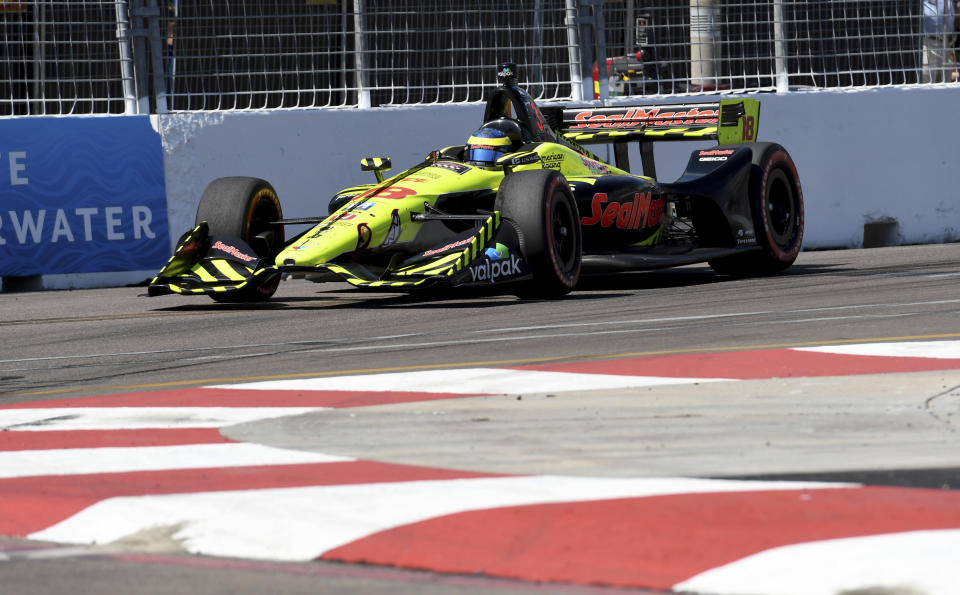 Sebastien Bourdais (18) races into Turn 10 before winning the IndyCar Firestone Grand Prix of St. Petersburg, Sunday, March 11, 2018, in St. Petersburg, Fla. (AP Photo/Jason Behnken)