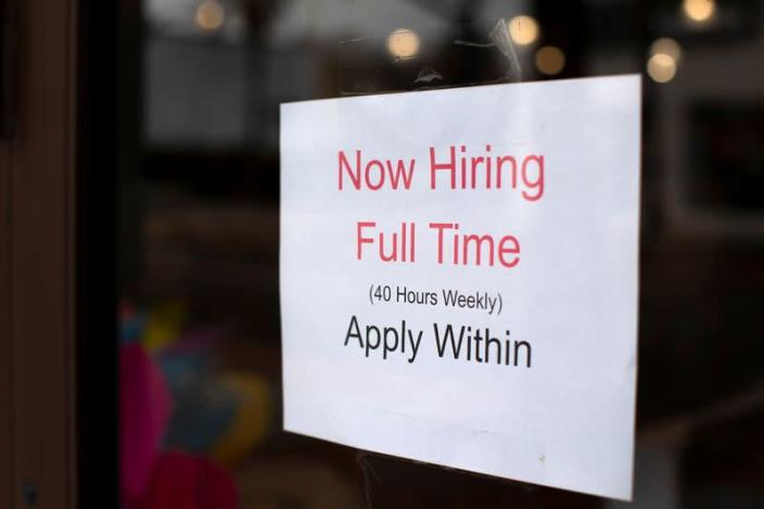 FILE PHOTO: A retail store advertising a full time job on its shop window in Oceanside, California,
