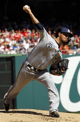 Milwaukee Brewers starting pitcher Yovani Gallardo delivers to the Washington Nationals during the first inning of a baseball game in Washington, Sunday, Sept. 23, 2012. (AP Photo/Ann Heisenfelt)