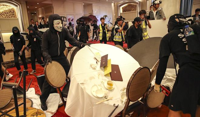 Protesters in Sha Tin trash a Maxim's Palace restaurant. Photo: Winson Wong