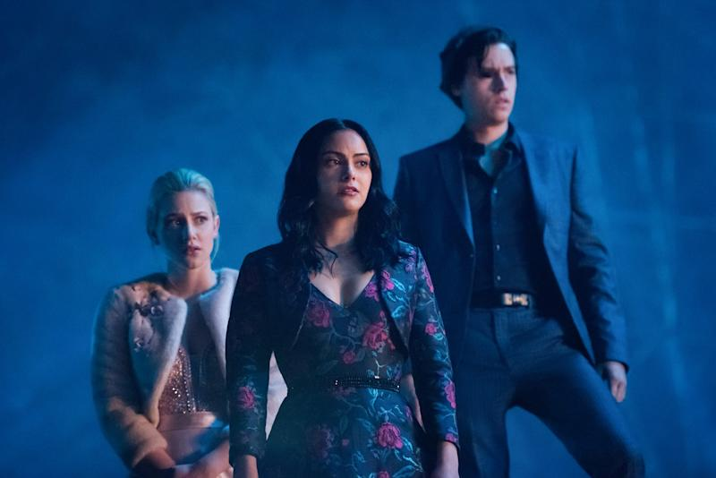 Betty (Lili Reinhart, left)., Veronica (Camila Mendes) and Jughead (Cole Sprouse) are entering their senior year on