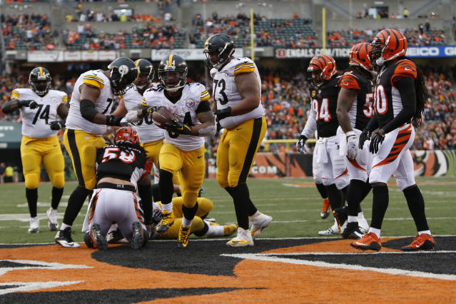 FILE - In this Dec. 13, 2015, file photo, Pittsburgh Steelers running back DeAngelo Williams (34) reacts after scoring a touchdown in the second half of an NFL football game against the Cincinnati Bengals, in Cincinnati. With their first playoff victory since 1990 seemingly secured, the Bengals went into one of the biggest meltdowns in NFL history and lost to the Steelers, ending their 2015 season. It was the start of six straight losses to their AFC North rival, a stretch of futility that they cant avoid as they get ready to meet again. (AP Photo/Frank Victores, File)