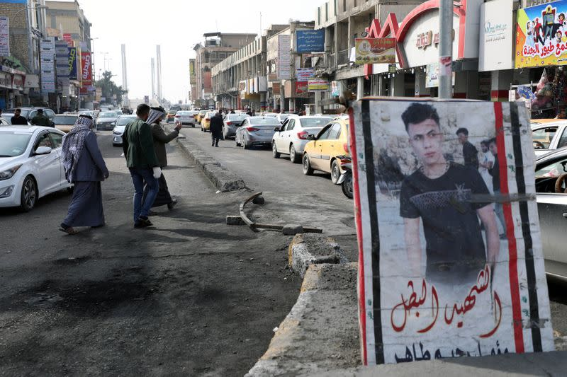 A picture of a demonstrator who was killed during anti-government protests, is seen in Nassiriya
