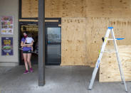 The Rouses grocery in Morgan City, La., is boarded up as residents prepare for the arrival of Hurricane Ida on Saturday, Aug. 28, 2021. The storm is expected to bring winds as high as 140 mph when it slams ashore late Sunday (Chris Granger/The Times-Picayune/The New Orleans Advocate via AP)