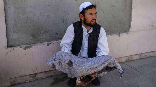 PHOTO: An Afghan man holds the body of a child killed when a bus hit a roadside bomb on the Kandahar-Herat highway, at a hospital in Herat on July 31, 2019. (Hoshang Hashimi/AFP/Getty Images)