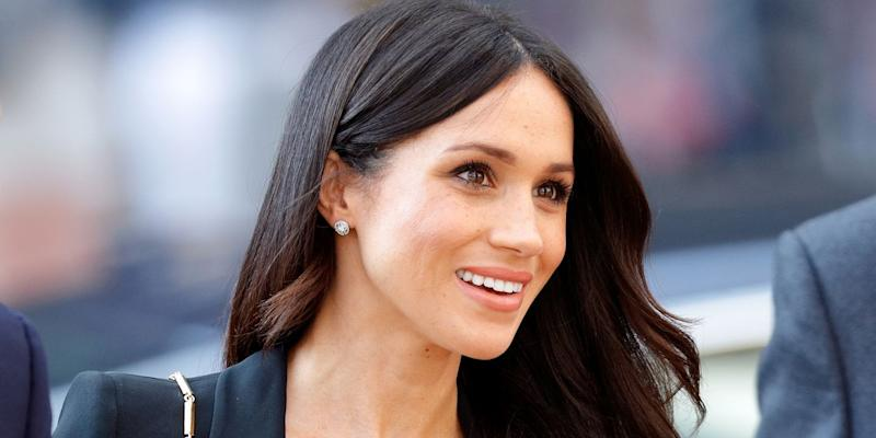 'Down to earth' Meghan closes her own vehicle  door