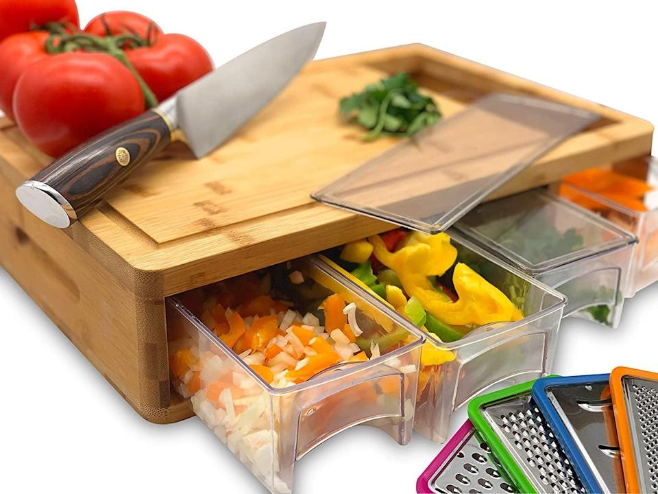 <p>How cool is this <span>Large Bamboo Cutting Board with Trays</span> ($43)?</p>