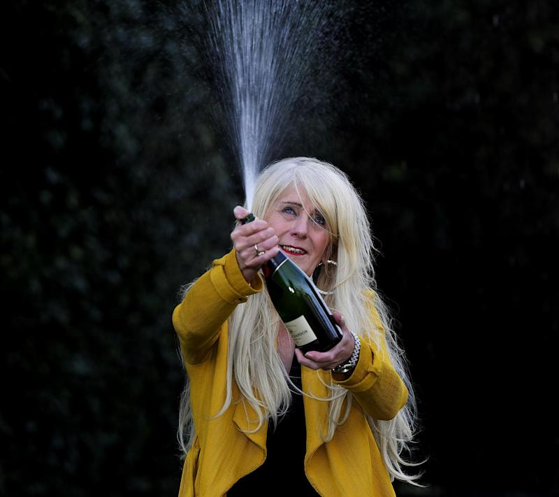 Taxi driver Melissa Ede, 57, celebrating during a photocall at Willerby Manor Hotel in Hull. (PA Archive/PA Images)
