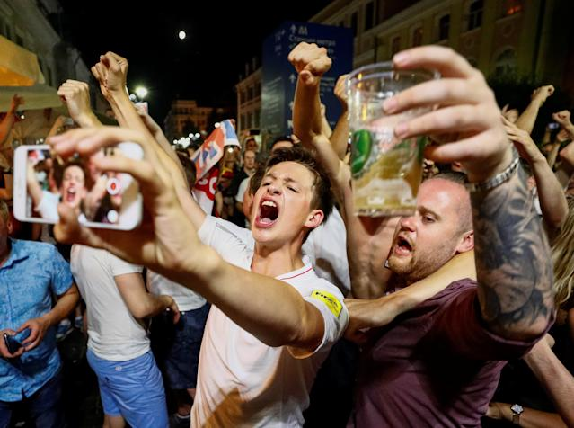 Soccer Football - FIFA World Cup - Group G - England v Panama - Nizhny Novgorod, Russia - June 23, 2018 - England fans cheer on a street. REUTERS/Gleb Garanich