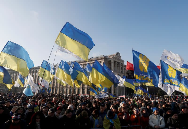 """People take part in a rally ahead of the so-called """"Normandy"""" format summit, in Kiev"""