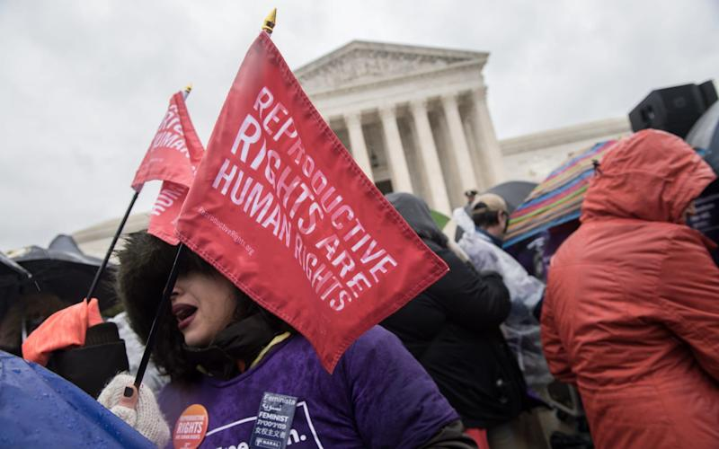 Pro-abortion activists demonstrate in front of the US Supreme Court in Washington, DC - AFP
