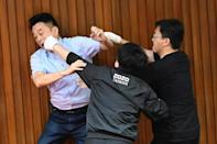 Lu Ming-che of the KMT (left) fights with DPP lawmaker Wu Ping-jui (centre)