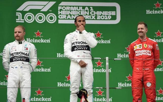 Lewis Hamilton, Valtteri Bottas and Sebastian Vettel on the podium at last year's Chinese Grand Prix (AFP Photo/STR)