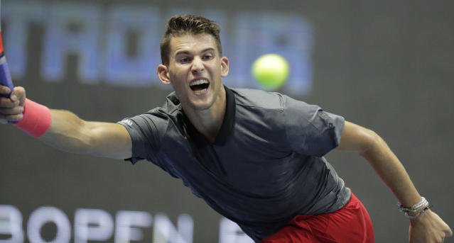 Dominic Thiem of Austria returns the ball to Daniil Medvedev of Russia during the St. Petersburg Open ATP tennis tournament quarter final match in St.Petersburg, Russia, Friday, Sept. 21, 2018. (AP Photo/Dmitry Lovetsky)