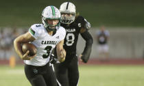 FILE - Southlake Carroll quarterback Quinn Ewers (3) runs for a first down against Permian during the first half of a high school football game in Odessa, Texas, in this Friday night Sept. 13, 2019, file photo. Third-year Ohio State coach Ryan Day opens a preseason camp for the first time without a good idea of who will be the starting quarterback. Quinn Ewers, the top quarterback prospect in the class of 2022 who says he is skipping his senior year of high school in Texas and plans to enroll at Ohio State is the wildcard. (Ben Powell/Odessa American via AP, File)