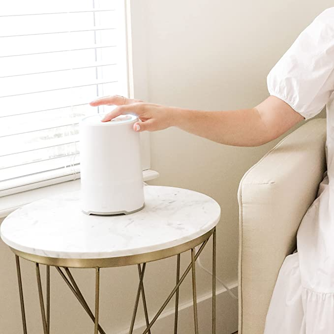 """<h2>Best Multi-Purpose Air Purifier</h2><br>This bite-sized 3-in-1 machine by Frida Baby is a sound machine, nightlight, and air purifier all in one. While it's designed to go in a child's room, its minimalist design makes it work for all ages and spaces. <br><br><strong>FridaBaby</strong> 3-in-1 Air Purifier + Sound Machine + Nightlight, $, available at <a href=""""https://amzn.to/3E6xuF1"""" rel=""""nofollow noopener"""" target=""""_blank"""" data-ylk=""""slk:Amazon"""" class=""""link rapid-noclick-resp"""">Amazon</a>"""