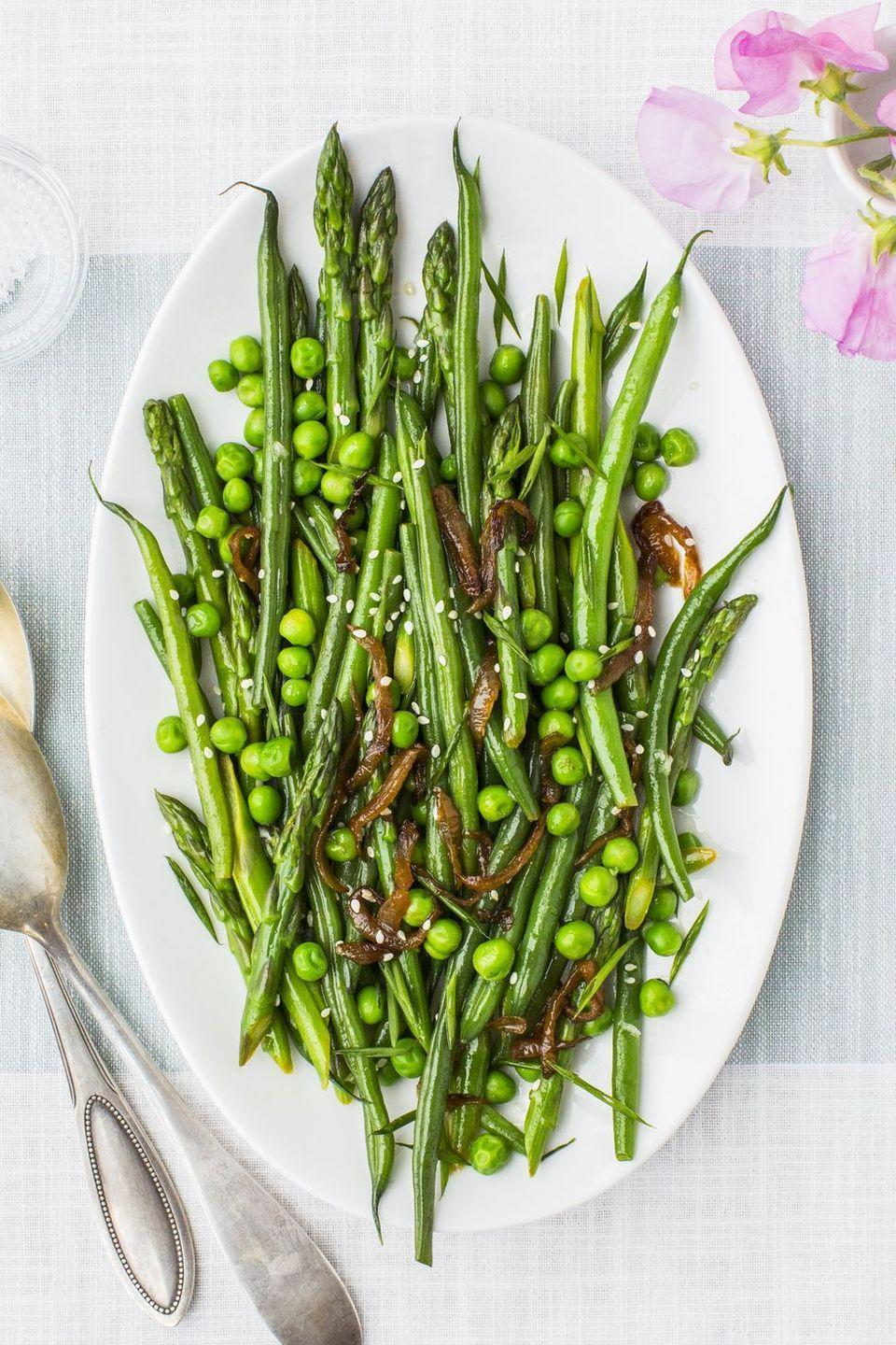 """<p>Vegetables tossed in a lemon juice, chive, sesame, honey and garlic vinaigrette with caramelized onions will be your family's go-to side for the spring holiday and beyond.</p><p><em><a href=""""https://www.goodhousekeeping.com/food-recipes/a43200/lemony-asparagus-beans-peas-recipe/"""" rel=""""nofollow noopener"""" target=""""_blank"""" data-ylk=""""slk:Get the recipe for Lemony Asparagus, Beans and Peas »"""" class=""""link rapid-noclick-resp"""">Get the recipe for Lemony Asparagus, Beans and Peas »</a></em></p><p><strong>RELATED: </strong><a href=""""https://www.goodhousekeeping.com/food-recipes/g30682230/easy-spring-recipes/"""" rel=""""nofollow noopener"""" target=""""_blank"""" data-ylk=""""slk:30 Spring Recipes That Make the Most of This Season's Produce"""" class=""""link rapid-noclick-resp"""">30 Spring Recipes That Make the Most of This Season's Produce</a></p>"""