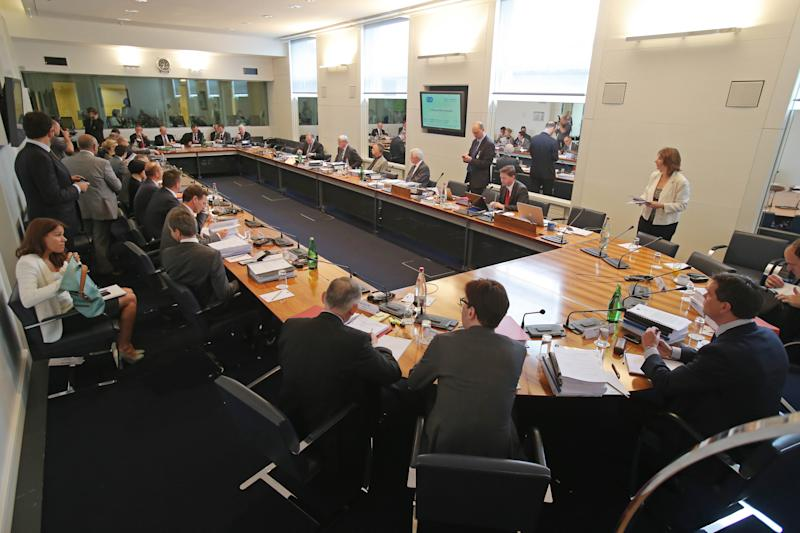 Participants sit around the table prior to the hearing at the FIA headquarters in Paris, Thursday, June 20, 2013. The hearing to determine whether Mercedes and Pirelli broke Formula One rules by holding in-season tire tests has opened in Paris. The International Automobile Federation (FIA) convened the international tribunal hearing to determine whether Mercedes gained a competitive advantage from the testing session in Barcelona last month. (AP Photo/Michel Euler, Pool)
