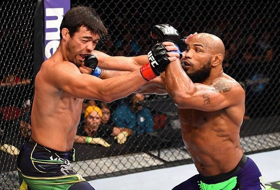 """Yoel Romero of Miami via Cuba beat former lightweight champ Lyoto Machida of Brazil in their middleweight fight during """"UFC Fight Night"""" on June 27, 2015 on FOX Sports 1 from Hard Rock Live at Seminole Hard Rock Hotel & Casino in South Florida, near Hollywood. Romero, who makes his Bellator debut Saturday, Sept. 18, trains with American Top Team in South Florida."""