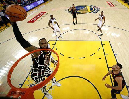 May 31, 2018; Oakland, CA, USA; Cleveland Cavaliers forward LeBron James (23) dunks the ball against Golden State Warriors guard Shaun Livingston (34) in game one of the 2018 NBA Finals at Oracle Arena. Ezra Shaw/pool photo via USA TODAY Sports