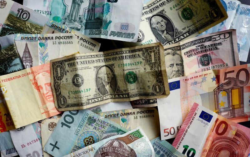 Bank notes of different currencies are photographed in Frankfurt, Germany, in this illustration picture