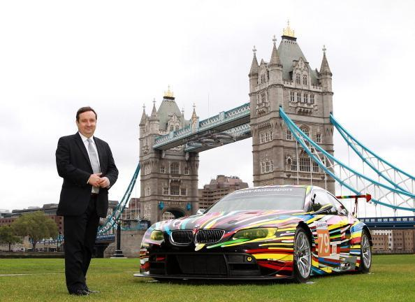 LONDON, ENGLAND - JULY 3: Gregor Muir, Executive Director ICA poses with the transformed M3 GT2 during the launch of BMW Art Car at Potters Field on July 3, 2012 in London, England. (Photo by Jan Kruger/Getty Images for BMW)