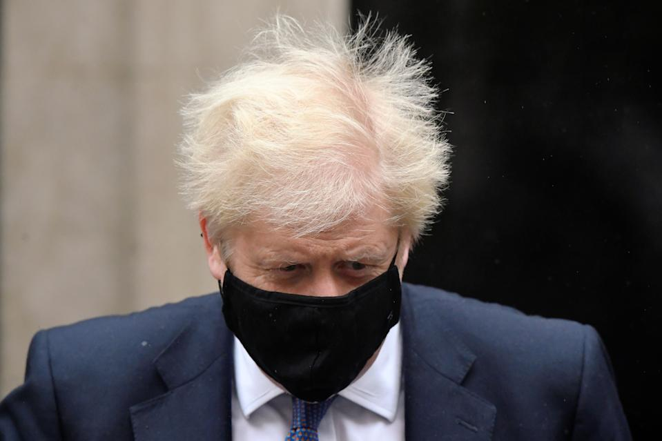 Britain's Prime Minister Boris Johnson, wearing a protective mask, leaves 10 Downing Street in London, Britain October 21, 2020. REUTERS/Toby Melville