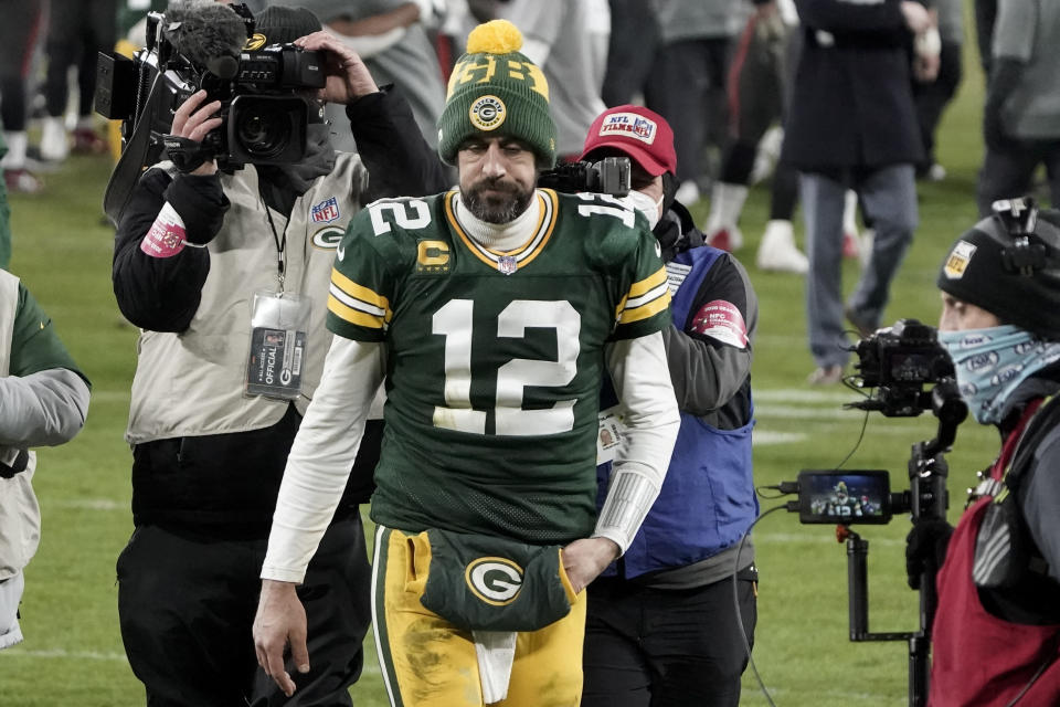 FILE - In this Jan. 24, 2021, file photo, Green Bay Packers quarterback Aaron Rodgers (12) walks off the field after the NFC championship NFL football game against the Tampa Bay Buccaneers in Green Bay, Wis. Green Bay Packers president/CEO Mark Murphy remains hopeful Rodgers the three-time MVP will play for them this season, but says he does not know whether Rodgers will arrive for the start of training camp. (AP Photo/Morry Gash, File)